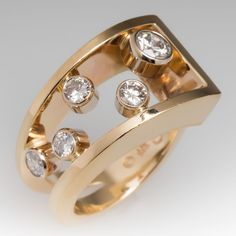Asymmetrical diamond cocktail ring in yellow gold