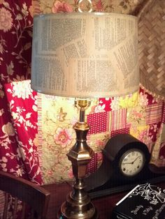 Flea market lamp with shade recovered in vintage book pages