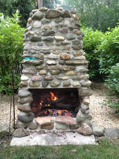 In less than a week my husband built us a fireplace in the backyard. Using rocks free from a local farm field (farmers hate them because they break their disks when plowing), cement slab and mortar and a few steel rods stabilizing the chimney stack and several days of layering rocks and drying, we gave a great focal point in our yard. We can burn sticks, roast hot dogs and marshmallows and relax in warmth from spring through fall, all while keeping the fire contained.
