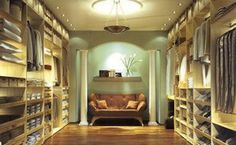 Now that's a closet!!  His side and Her side with seating.