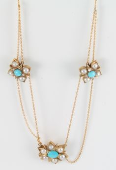 Lot 706, An antique yellow gold turquoise and seed pearl triple cluster necklace, est £150-200