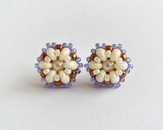 Tiny handmade beaded stud earrings in ivory, purple and bronze colors.  Beautiful and unique beaded stud earrings made with ivory czech Superduo beads,