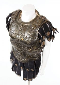 Ferdy Mayne complete cuirass and helmet from Ben-Hur. (MGM, 1951) Ornate cuirass worn by Ferdy Mayne as the Captain of the rescue ship in Ben-Hur. Constructed of molded fiberglass decorated with cherubs and griffons, cloth at the neck, with hand-painted gold details, black leather apron decorated with gold cherub faces.