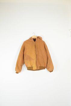 DISTRESSED WORKWEAR JACKET // size mens large // 90s // coat // hooded // grunge // outdoors / hood / utilitarian / black / vtg vintage by GUTTERSHOP on Etsy https://www.etsy.com/listing/531475531/distressed-workwear-jacket-size-mens