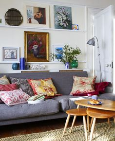 looks cozy and colorful, especially like the collection of pillows and frames.