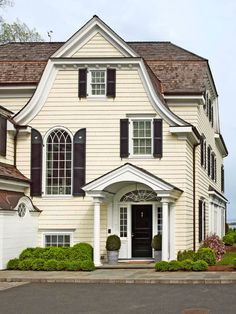 A very eclectic exterior: classical portico; federal door with side and fan lights, gothic and cottage windows, and numerous roof styles. Exterior Paint Colors For House, Paint Colors For Home, Sarah Richardson, Yellow Houses, Waterfront Homes, Elegant Homes, Traditional House, Traditional Shutters, House Painting