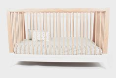 White wooden crib by Nobodinoz.  It is TONS of money!  But, what if I bought an Ikea crib and painted the bottom gold?  Cute!