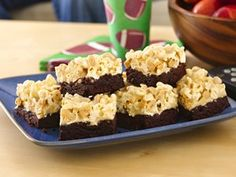 Stadium Brownies -- These #brownies are topped with a marshmallow, popcorn, and peanut mixture making the ultimate salty & sweet #tailgating treat.