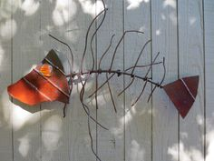 painted scrap metal fish with glass eye