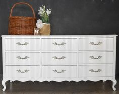 High gloss Pure White paint by Sherwin Williams. This vintage French Provincial style dresser was painted by Alchemy fine living in Santa Ana with Solo paint.