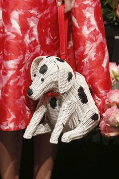 A tisket, a tasket — a black-and-white spotted basket bag from @katespadeny lends the dalmatians a new look for spring. [Photo: George Chinsee]