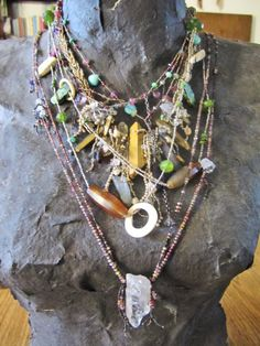 I love the way the artisan added the crystal pendant at the bottom.  .....Lots of beads! A weeks work LuciaAntonelli.com