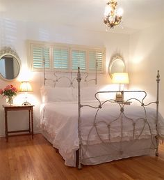 """Beautiful """"four poster"""" antique iron bed we converted the side-rails to accommodate a queen size mattress"""