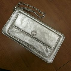 "Michael Kors wristlet Silver leather Michael Kors wristlet. 8"" x 4.5"". Some tarnish on the chain as visible in second pic. A few marks here and there. Priced accordingly. Rhinestone snap makes it so pretty!   Make me an offer! Michael Kors Bags Clutches & Wristlets"