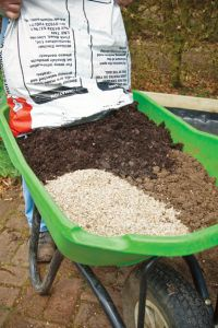 square foot gardening soil mix: 1/3 Coarse Grade Vermiculite 1/3 Spagnum Peat Moss 1/3 Blended Compost