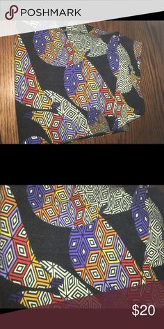 LuLaRoe TC Leggings Paisley Design These were worn once, washed once. Black background with paisleys in white, black, purple, red, yellow, orange. Made in Vietnam. We are a smoking and pet household so you are aware. LuLaRoe Pants Leggings