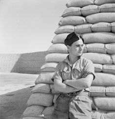 Beaton, Cecil -- Cecil Beaton portrait photograph of a Royal Air Force officer in the Western Desert, 1942.