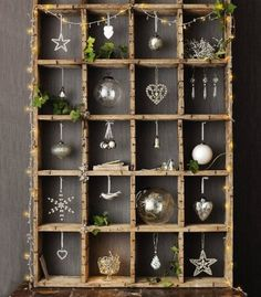 Silver & mercury glass ornament display. Looks like an old soda crate....