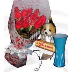 Send this one dozen of red roses in a bouquet to your sister on Christmas Day with blue vase, heart string necklace, round shaped toblerone and dog stuff toy. Bring on rose envy with our gorgeous bouquet of one dozen stunning red roses. Send it with your sweet message to add more sparkle on Christmas Day. Online Flower Shop, Toblerone, First Anniversary, Most Favorite, Dog Stuff, Perfect Match, Dog Toys, Chocolates, Red Roses