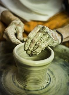 Creating a bowl on the pottery wheel.  Photo courtesy of Corey Coppinger