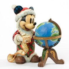 jim shore disney seasons greetings around the world disney figurines collectible figurines wooden figurines