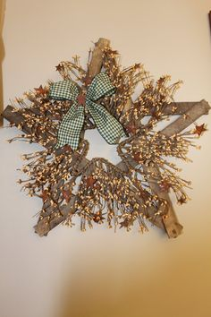 Tobacco Lath Star with Pip Berries Bow and by PotpourriandLighting