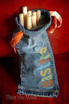 Use the leg from an old pair of jeans to make a sturdy bag to store roasting sticks for campfires