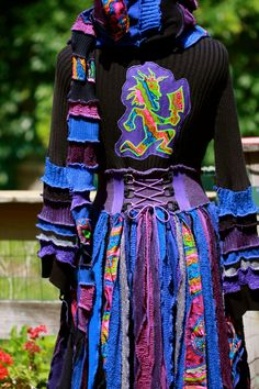 SuperDuperUbberAwesome Custom upcycled gypsy dream traveling faery  patchwork ragamuffin elf pixie rave recycled sweater coat. $544.44, via Etsy.