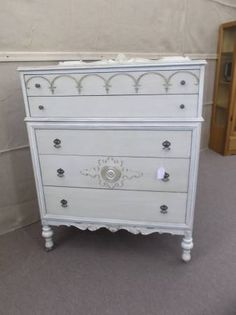 $325 - This antique chest has five drawers - painted creamy white, distressed lightly and finished with an golden oak wax! ***** In Booth E5 at Main Street Antique Mall 7260 E Main St (east of Power RD on MAIN STREET) Mesa Az 85207 **** Open 7 days a week 10:00AM-5:30PM **** Call for more information 480 924 1122 **** We Accept cash, debit, VISA,