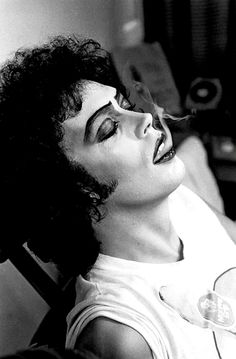 Tim Curry photographed by Mick Rock on the set of 'The Rocky Horror Picture Show' (1975).