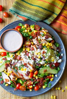 Fresh and zesty Mexican Grilled Chicken Salad loaded with veggies and topped with spicy tomato ranch dressing. Not your average Grilled Chicken Salad recipe