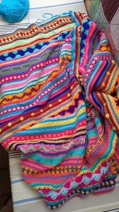 I like the way this is made up of different stitches in different colours.. It looks like an Indian rug