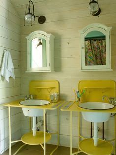 Eclectic details.  plumber converted these vintage hospital enamel basins and stands into Jack and Jill sinks for the upstairs bath, adding unique character.