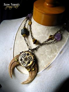 CELTIC TRISKELION Cave Lion Claws Fossil Talisman Amulet Necklace by Susan Tooker of Spinning Castle.