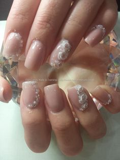Wedding nails! brillbird nude acrylic with swarovski crystals, pearls and caviar beads with 3d acrylic flowers