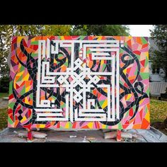 #3) eL Seed mainly focuses on Arabic calligraphy and he says that he hopes to break barriers and stereotypes with his art. His inspiration comes from the past and he creates hope for the future with his work. When he started out, he first began to paint his name on the street of Paris, but with time, he realized his love for Arabic calligraphy and instead he began to paint that.