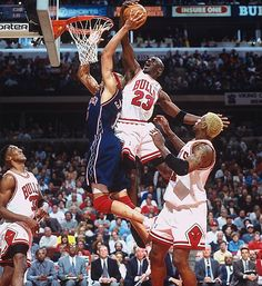 Jordan rejects the New Jersey Nets' Chris Gatling at the rim in Game 1 of an Eastern Conference playoffs first-round series in 1998. With Jordan scoring 32 or more points in each game, the Bulls made quick work of the Nets, eliminating them in three games.