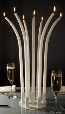 Curved tall dinner candles burning