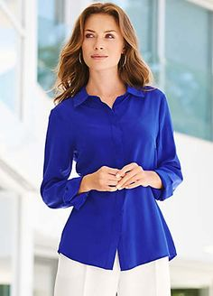 The ultimate in sophisticated style, this tailored, silk shirt feels wonderful on and features a concealed front button fastening.  Washable  100% Silk  Length approx. 68 cm (27 ins)