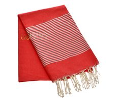 """Shown from our luxury Lurex fouta line is our red with silver stripes and white fringe. 100% cotton. 78""""x39"""" imported from Tunisia."""