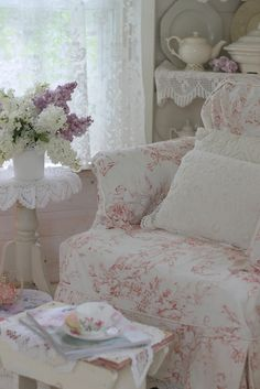 shabby chic inspiration - LOVE this! Lace curtains letting in light, doily-draped side table and shelves, graceful white-painted table leg, pink-on-white slipcovered chair, graceful porcelain teapot on shelf (love the lines!) white and lavender lilacs(? Cottage Shabby Chic, Shabby Chic Homes, Shabby Chic Style, Shabby Chic Decor, Cottage Style, Romantic Cottage, Rose Cottage, Shabby Bedroom, Chabby Chic