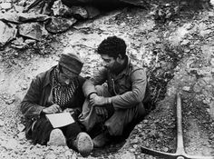 Madrid, Spain. Republican Soldiers writing a letter. By Robert Capa, (November-December 1936)