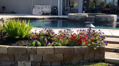 Stacked stone retaining wail with spring color