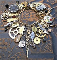 One of a kind Steampunk inspired charm bracelet with a variety of clock gears, ornate brass hands, pocket watch parts and intricate vintage jewelry findings.  Part of a private collection.