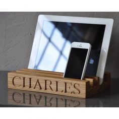 This will look stunning on your desk or kitchen top, and help you keep track of important papers, iPad, phones etc.  You can choose from one of our standard engravings; Ipad etc., Neat & Tidy, Mum's Tidy or Dad's Tidy, or personalise it with a housename, initials or names.  Measures: 23 x 15 x 3.5 cm  In solid oak, beautifully hand engraved in our Kent workshop.  Please note if you want personalisation then this can take up to 10 days