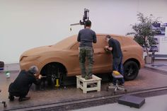 Modelers work to refine a full scale model of the 2014 Nissan Qashqai