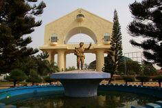 https://flic.kr/p/DRVqth | Arch 22, Landmark in Banjul, the Gambia | Buy this photo on Getty Images : Getty Images Arch 22 is a commemorative arch on the road into Banjul in the Gambia. It was built in 1996 to mark the military coup d'etat of July 22, 1994, through which Yahya Jammeh (thereafter president of the nation) and his Armed Forces Provisional Ruling Council overthrew the democratically elected Gambian government. The Arch stands on the Banjul-Serrekunda Highway, near the traffic...