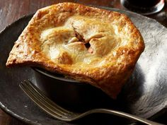 Beef Potpies With Cheddar-Stout Crust: The potpie filling and dough can be made a day ahead. Let the filling cool, then refrigerate and reheat before assembling.