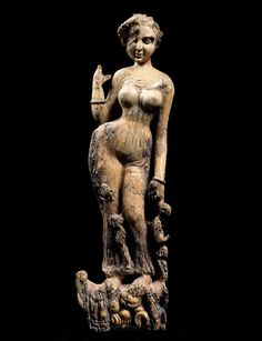Treasures from Afghanistan:Hellenic cultural and artistic influences can be found in many of the pieces and those at Tillya Tepe were found alongside artefacts from China and India.  Statuette of a woman standing on a makara, possibly a furniture ornament from the 1st-2nd centuries AD made from ivory.