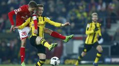 Football Soccer - FSV Mainz 05 v Borussia Dortmund - German Bundesliga - Coface-Arena, Mainz, Germany - 29/1/17 - FSV Mainz 05's Niko Bungert and Borussia Dortmund's Marco Reus in action.  REUTERS/Ralph Orlowski      DFL RULES TO LIMIT THE ONLINE USAGE DURING MATCH TIME TO 15 PICTURES PER GAME. IMAGE SEQUENCES TO SIMULATE VIDEO IS NOT ALLOWED AT ANY TIME. FOR FURTHER QUERIES PLEASE CONTACT DFL DIRECTLY AT + 49 69 650050.